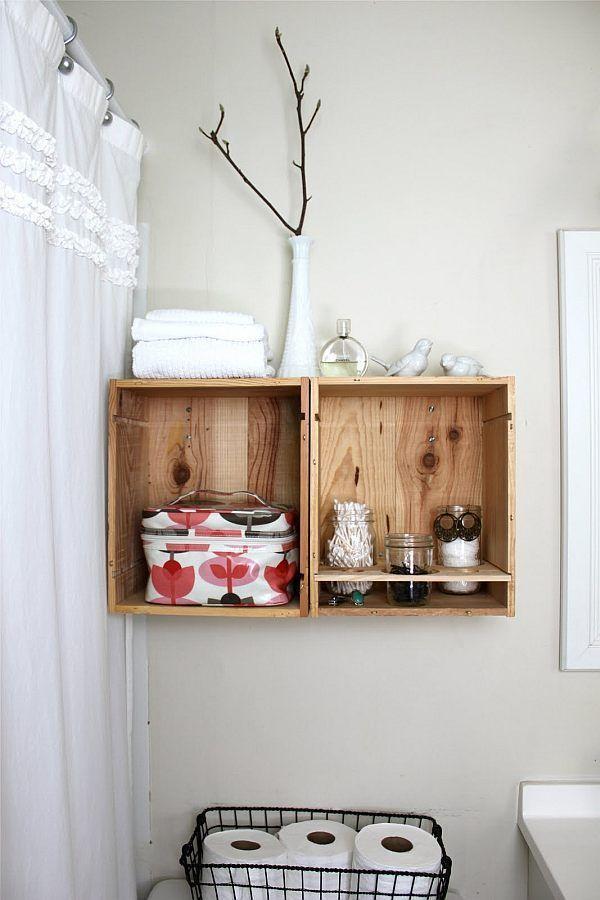 "Foto: Reprodução / <a href="" http://www.decoist.com/2013-04-04/diy-wood-wine-crates-ideas/diy-wine-crate-holders-in-the-bathroom/"" target=""_blank"">Decoist</a>"
