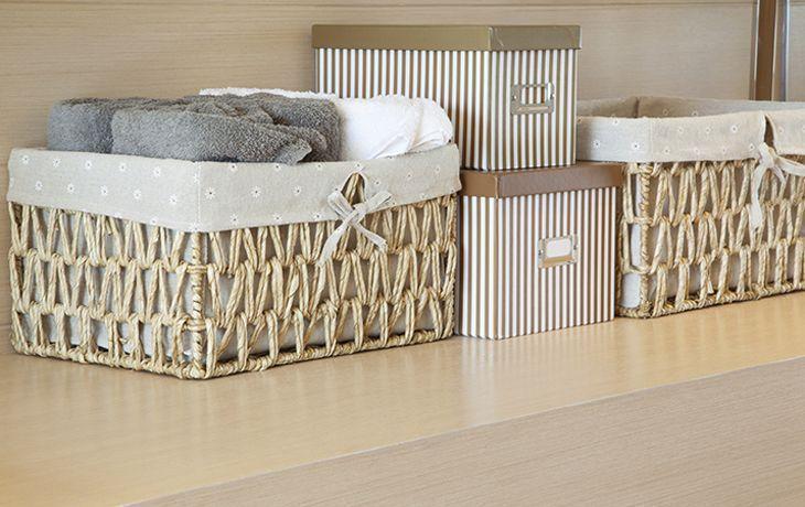 basket of towels on wooden