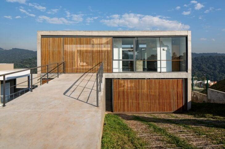 Garagem residencial 80 inspira es para deixar seu for Aggiunta in cima al garage